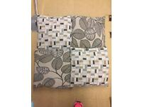 Set of 4 cushions with reversible pattern.