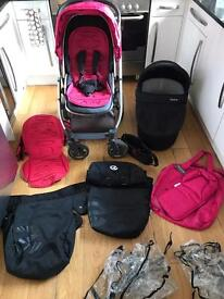 Oyster Travel System with carry cot and 2 colour packs pink and red
