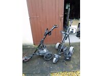 Two electric golf trollies