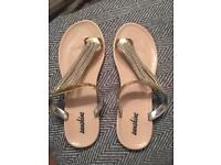 Gold diamonte flip flops size 8