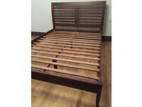 Stylish solid wood double bed frame by Julian Bowen in very good condition, 140cm W