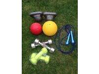 Mini gym set with dumbbells, medicine balls, kettlebells and skipping rope