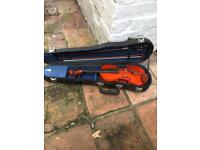 Child's violin and case
