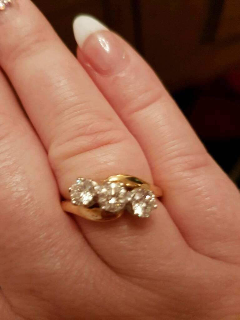 1.5 carat diamond ring on finger