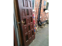 Exterior hardwood door with frosted yellow glass