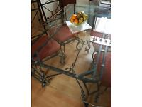 Wrought iron Glass dining table. 6 seater