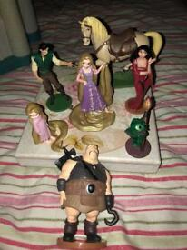 Disney figures rapunzel and sleeping beauty