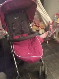 Sliver cross pushchair in purple/pink. Very good condition only used a hand full of times.
