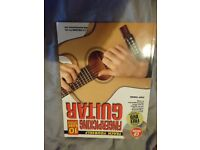 Teach yourself fingerpicking guitar with CD and DVD