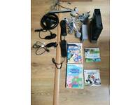 Wii console with games and 2 remotes