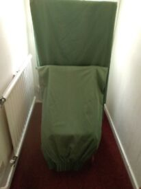Large pair of plain green curtains