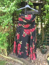 Black with rose print short evening dress.