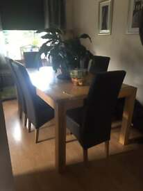 6 leather seats & solid Dining Oak Table.
