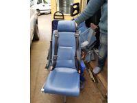 Van seat with double seatbelt
