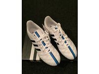 **New** Boys Adidas 11questra turf trainers.