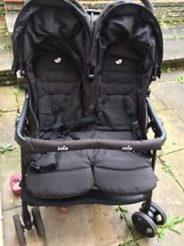 Double pushchair with raincover