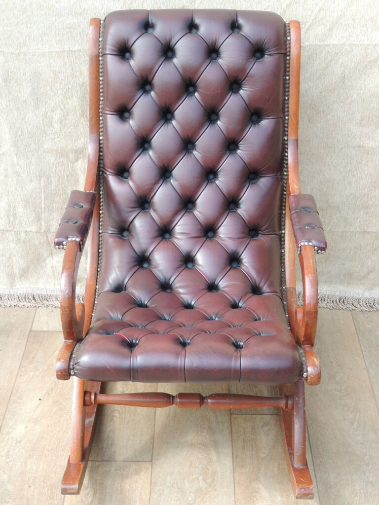 Chesterfield Rocking chair (Deliveryin Eltham, LondonGumtree - Chesterfield leather rocking chair (Size 63cm W; 91cm D; 96cm H); Genuine leather; Deep dark / black pushed in buttons to the back and seat; High density foam with luxury high back provides comfy seating position; Low chair suitable for nursing,...