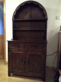 Dark wood dresser with back. 2 drawers, 2 cupboards. Possibly Old Colonial. Good condition.
