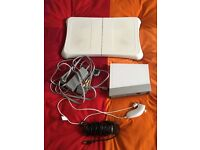 Wii console, cables, Wii fit board and accessories