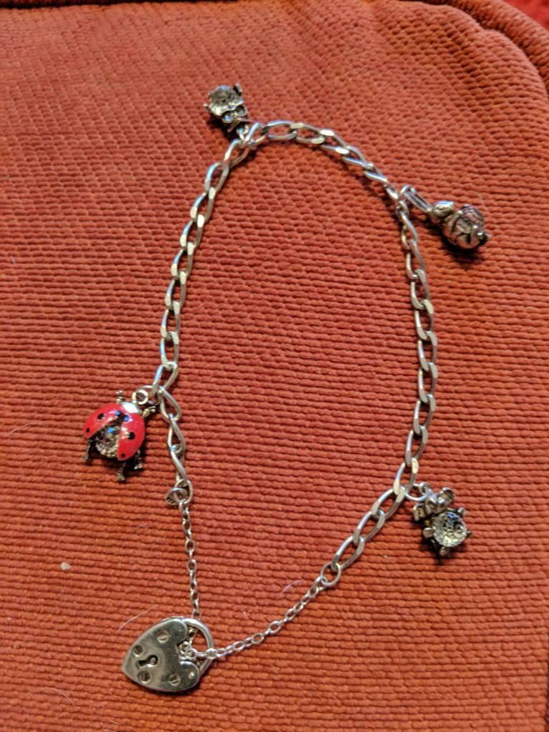 Silver charm bracelet.