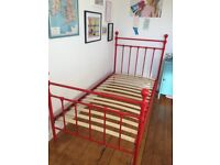 Red metal single bed