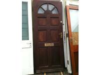 Exterior hardwood door with crazed halfcircle glass