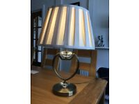 Table lamp with shade.