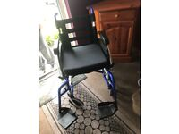 Wheelchair with seat cushion and foot rests. Selling due to no longer needing it brilliant condition