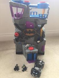 Batman bat cave with batmobile and 2 batman characters