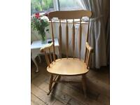 A SUPER BLONDE WOOD ROCKING CHAIR WITH FLAT SPINDLES FOR COMFORT