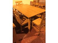 ex display dining table and six chairs- never used