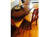 Table with four chairs good condition
