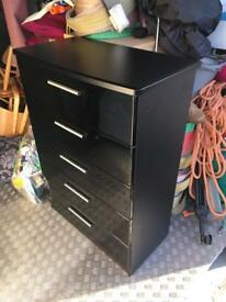 Gloss black chest of drawers