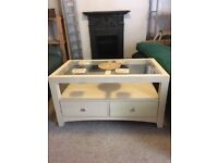 Glass top table with storage