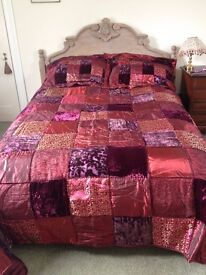Beautiful new, luxury, embroidered, burgundy coloured bedspread with pillow cases for double bed
