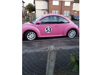 Pink vw beatle