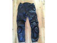 Black leather motorcycle trousers.