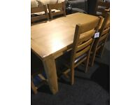 Solid oak extend table and six oak chairs, leather seats