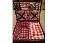 Unused picnic basket with plates, cutlery and cups