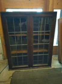 Oak wall cabinet with original leaded glass doors