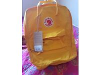 Ive got brand new kanken bagpack to sell. Yellow colour with all labels.