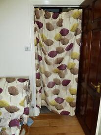 Sanderson 'Dandelion' pattern curtains.