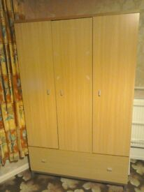 Wardrobe. Three doors with large lower drawer.