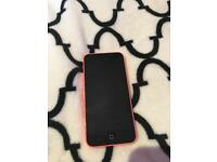 Pink iPhone 5C with accessories