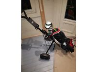 Child's golf club set including adjustable trolly