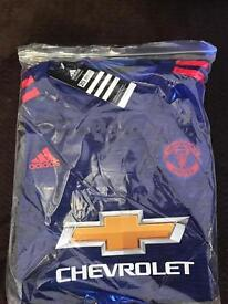 Boys age 5/6 Man Utd replica kit