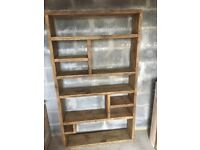 Reclaimed wooden bookcase with storage compartments.