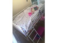Child's bed with steps guard and bedding