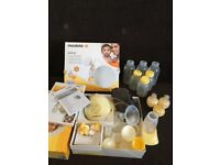 Medela swing single breast pump complete set + extra spare parts
