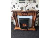 Solid wood fire surround with electric fire